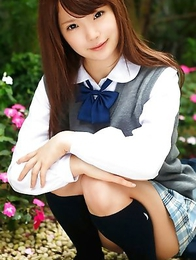 Manami Sato in short uniform skirt spends time in the park