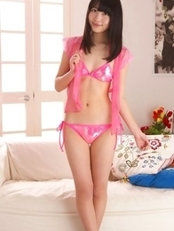 Hijiri Sachi has sexy tummy and juicy jugs in pink lingerie