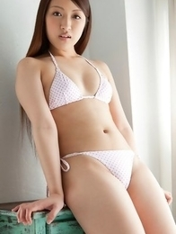 Cocoro Hirahara takes long socks and shorts off for camera