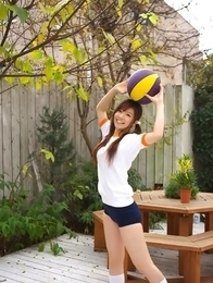 Cocoro Amachi in shorts plays with ball and bike in garden