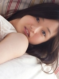 Mayumi Yamanaka with big hooters smiles and is very playful