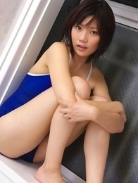 Airi Sakuragi puts soap and shower on body over bath suit