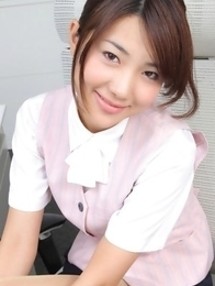 Naoho Ichihashi in fancy outfit sits with ass on the office