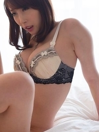 Aya Kisaki strips to her lingerie and gives this horny Japanese dude a footjob